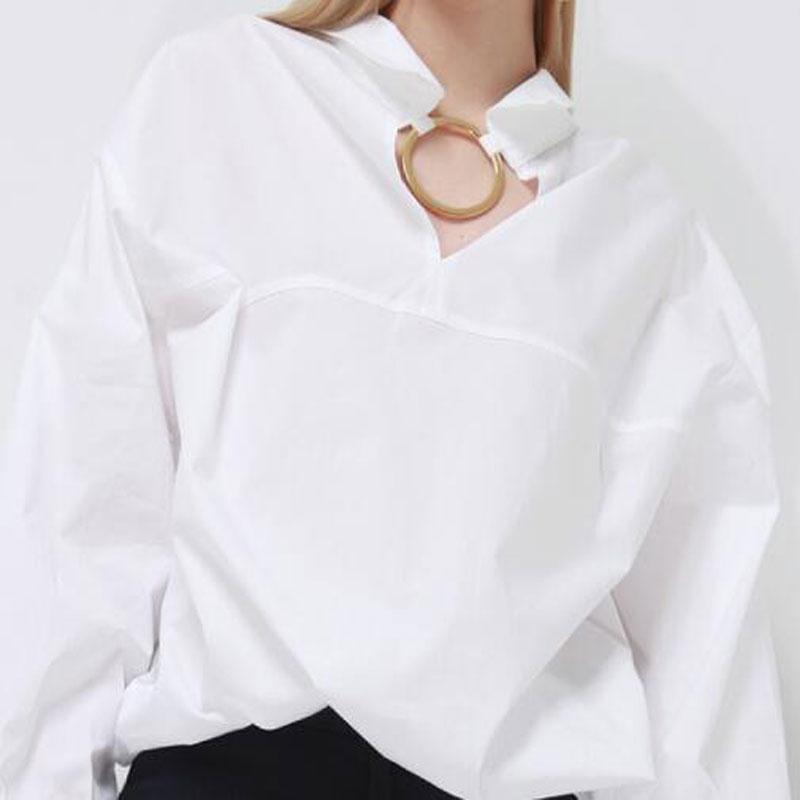 Металлические кольца на одежде